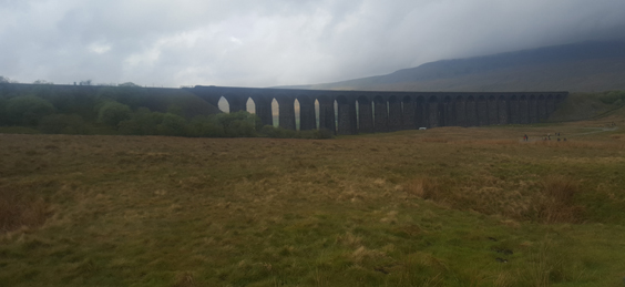 Climbing Pen-y-Ghent The Start of The Yorkshire Three Peak Challenge ribblehead viaduct