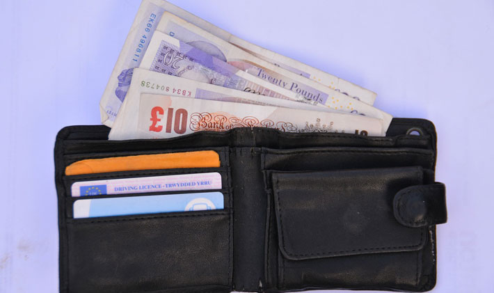 Nearly Half of Over 55s are using equity release to pay of Debts wallet