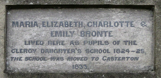 Dedication plaque on the side of the former school - the model for Charlotte Brontë's foreboding 'Lowood Institution' in Jane Eyre.