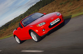mazda mx5 roadster coupe review