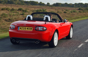 mazda mx5 roadster coupe rear view red top down convertible