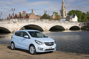 vauxhall viva sl in sky blue near water and a bridge