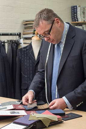 yorkshire tailor working with fabric smaples